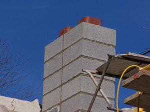 Cinderblock chimney.